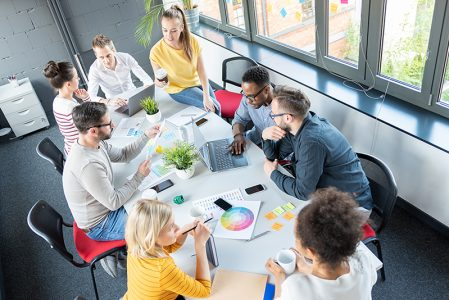 Young business people meeting at office and discussing together a new startup project.